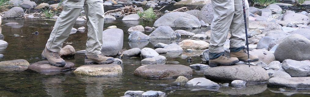 Rock hopping across creek on Nature Bound's guided walks in Australia
