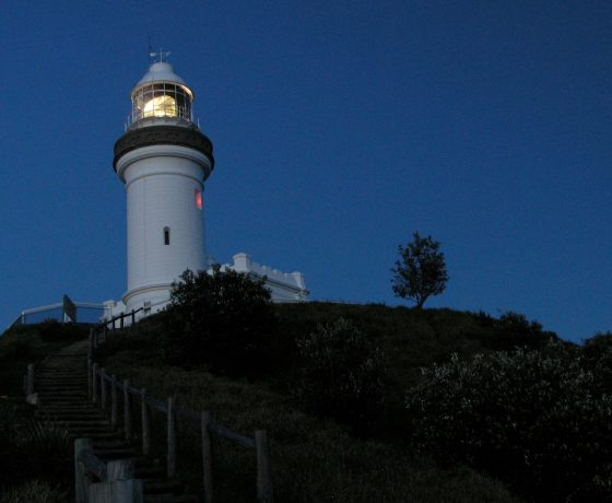 The lighthouse situated high on Cape Byron, Australia's most easterly landfall where we rise before dawn to walk the beach in moonlight arriving on the Cape for sunrise over the Pacific Ocean