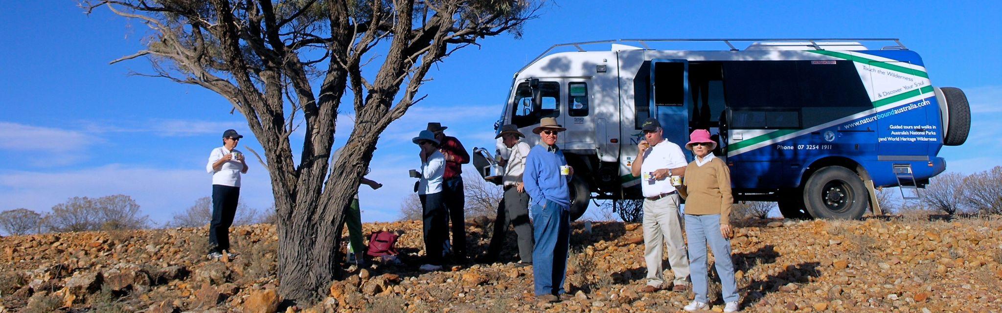 Tea break near tour transport on Mt Wood Station