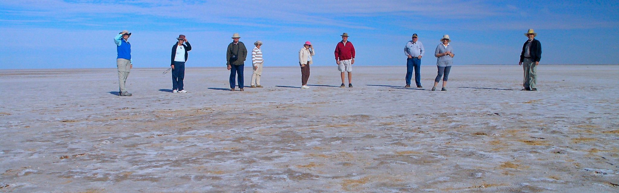 Tour group walking on Lake Eyre on Flinders Ranges, Lake Eyre Red centre Tour
