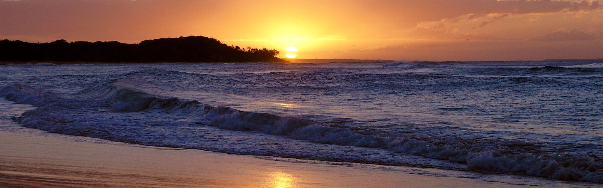 Sunset over Byron Bay, symbolic of best time to holiday in Australia