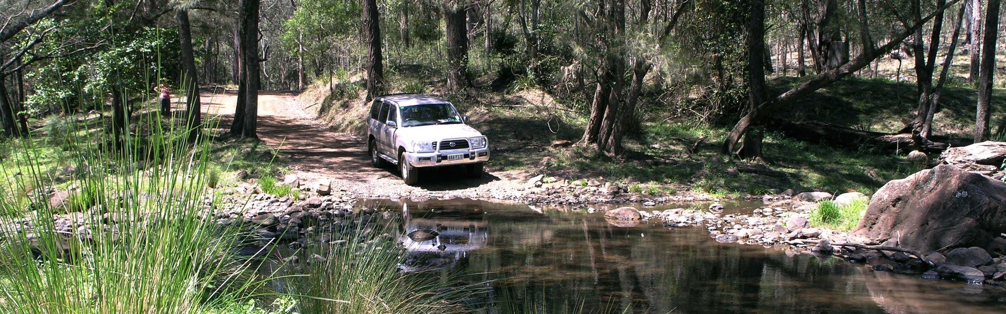 4WD vehicle entering Condamine River crossing on Border Ranges Short Break tour