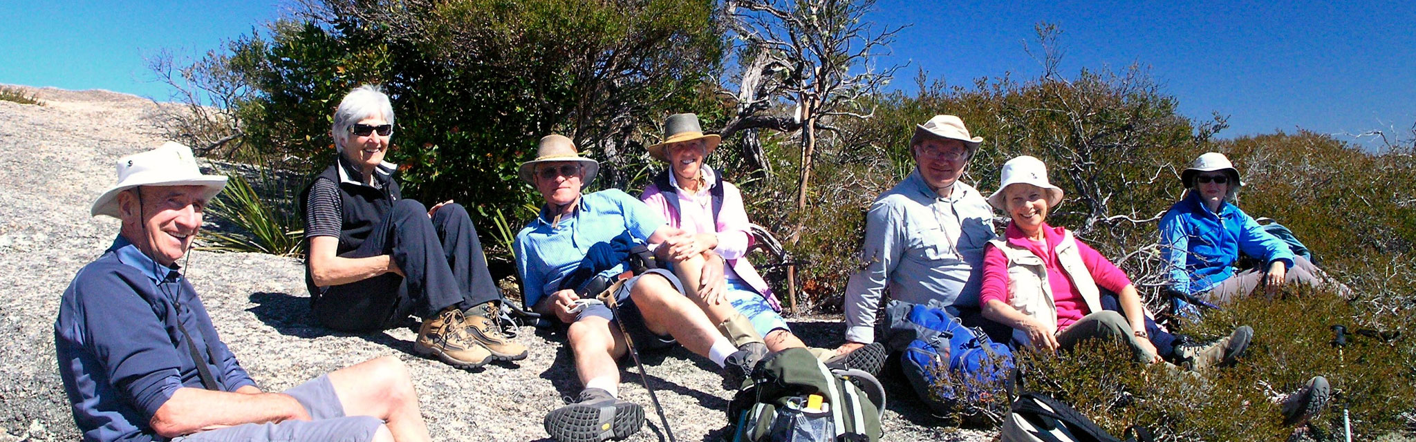 Tour Group relaxing on Bald Rock on Seniors Over 50s Holidays