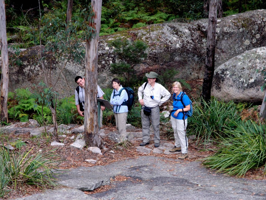 Smiles all around when connecting to nature at Bald Rock National Park on our Great Divide Iconic Landscapes Tour