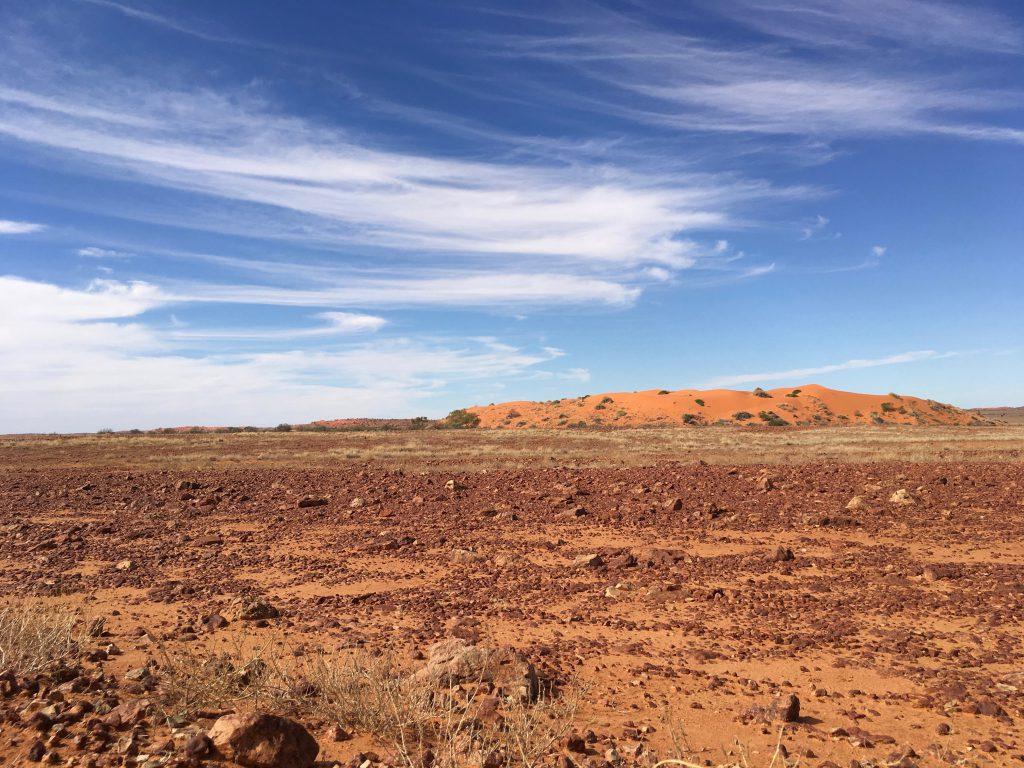 The Sturt's Stoney Desert of polished red gibber stones borders the red sand ridges of the Strzelecki Desert